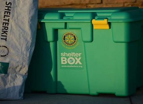 ShelterBox's signature green boxes containing essential aid items, including tents, solar lights, blankets, mosquito nets, and cooking sets, to help families rebuild after their lives have been devastated by disaster.
